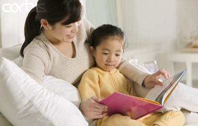 Mother and Daughter Reading --- Image by © Jamie Grill/Corbis